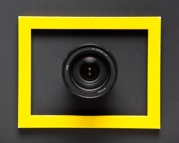 Camera lenses inside a yellow frame on black background