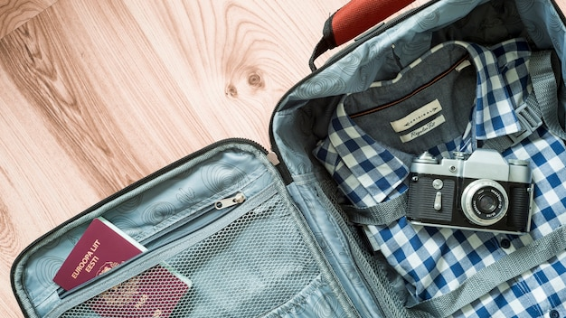 Camera and passport in suitcase