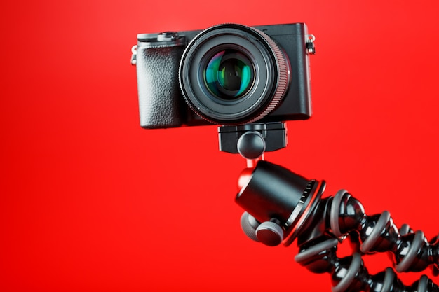 Camera on red. record videos and photos for your blog or report.