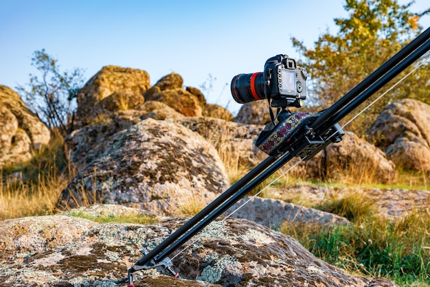 Camera on slider shots footage of beautiful hills covered with autumn trees in the carpathians mountains
