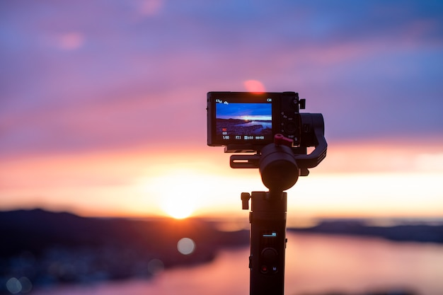 Camera on stabilizer is recording beautiful view at twilight