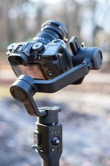 Camera on a steadicam. winter, trees on the background