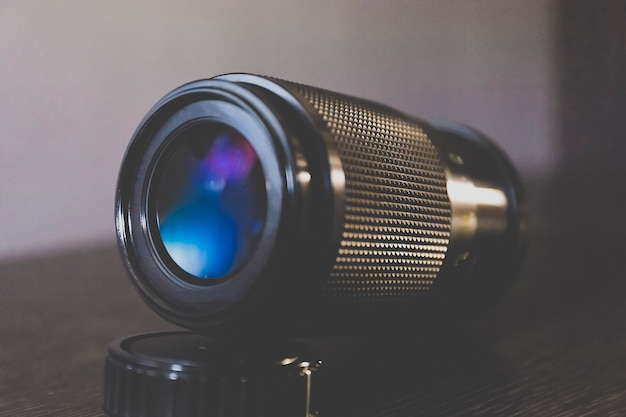 Camera tele lenses with blue tone