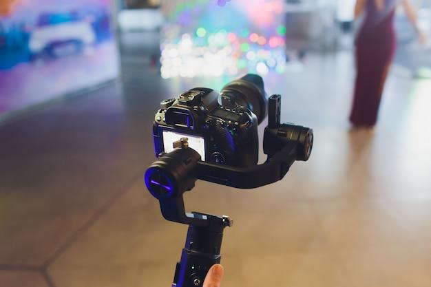 Camera on tripod photographers take photo session.