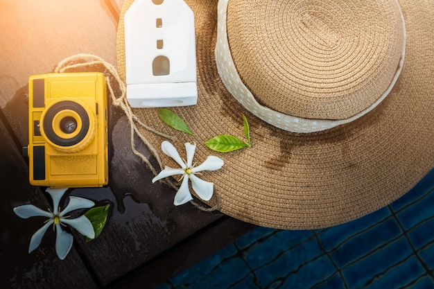 Camera vintage with woman hat on pool side terrace in concept holiday.