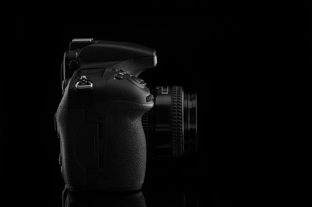 Camera with lens on black background.