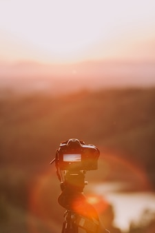 Camera with nature background.
