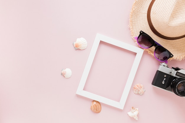 Camera with straw hat, shells and frame
