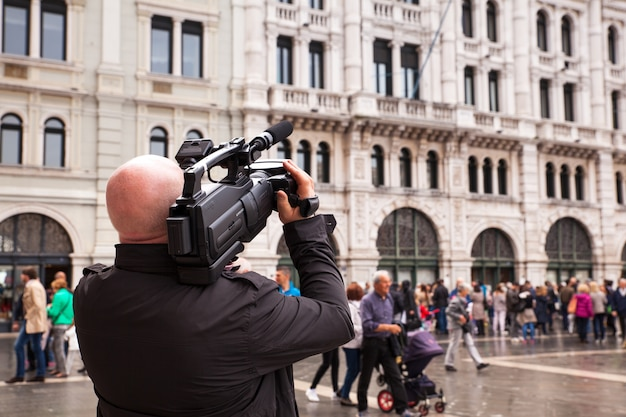 Cameraman take a movie in the street