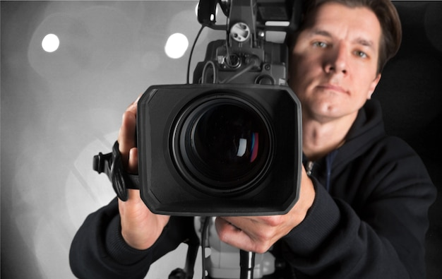 Cameraman working with camera  on background