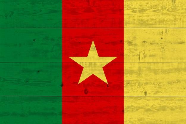 Cameroon flag painted on old wood plank