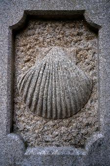 Camino santiago stone shell sign in combarro