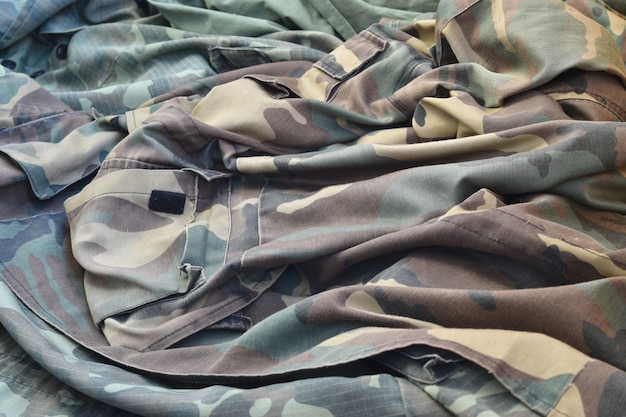 Camouflage background texture as backdrop for army and military design projects