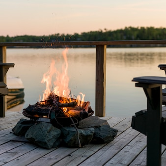 Campfire on a deck, lake of the woods, ontario, canada