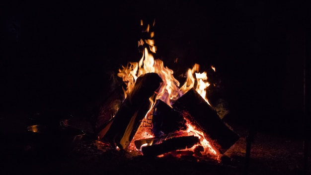 Campfire glowing in the