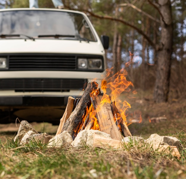 Campfire and van in nature