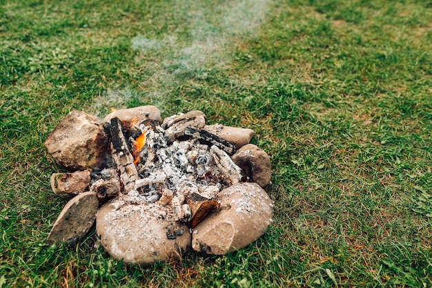 Camping bonfire on grass background