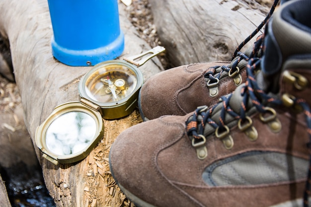 Camping and hiking equipment with shoes and compass outdoor
