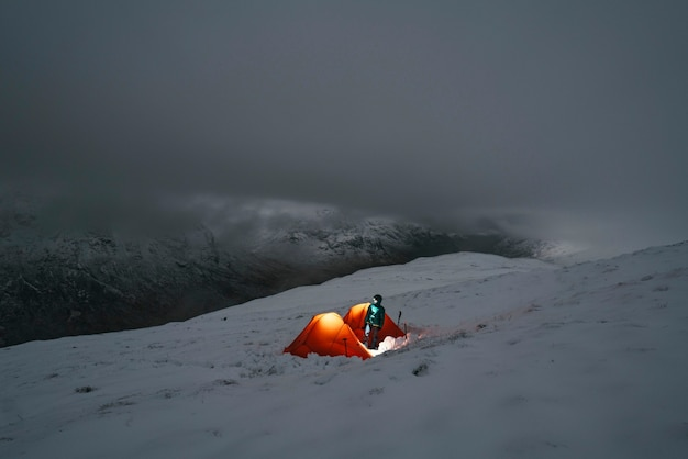 Camping at a misty snowy mountain top