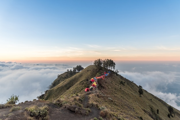 Camping site on crater rim of mount rinjani at sunset.