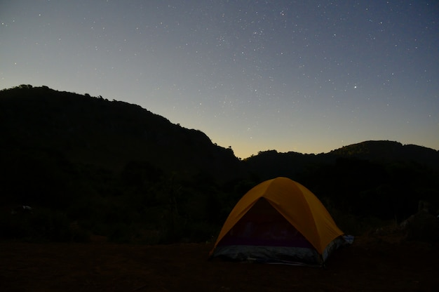 Camping tent mountain view and star with night time.