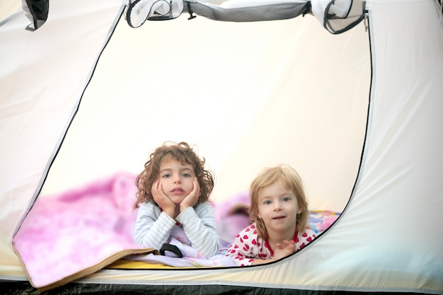 Camping tent vacation with two little girls