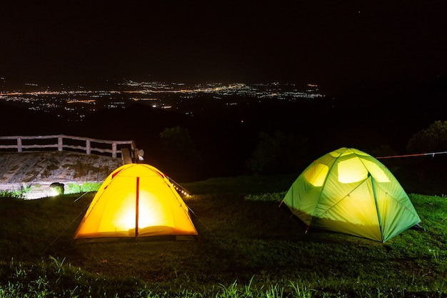 Camping tents on the mountain during sunrise in chiang rai, thailand.