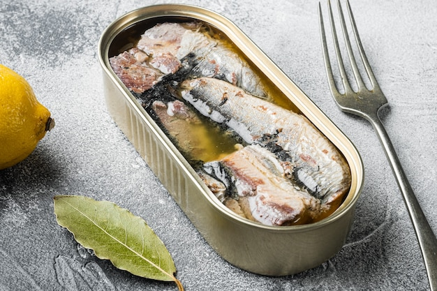 Can of sardines in olive oil set, on gray stone table background
