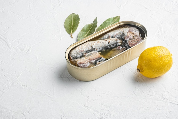 Can of sardines in olive oil set, on white stone table background, with copy space for text