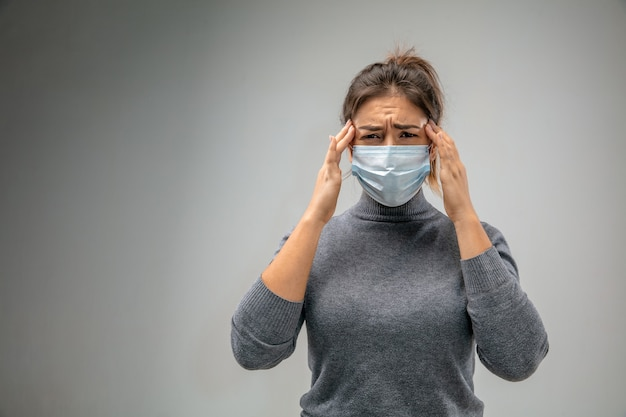 Can't breathe. caucasian woman wearing the respiratory protection mask against air pollution and dust particles exceed the safety limits. healthcare, environmental, ecology concept. allergy, headache.