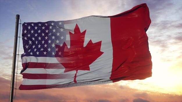 깃대에 캐나다와 미국 국기입니다. 바람에 물결 치는 미국 및 캐나다 혼합 깃발