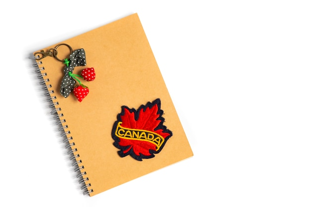 A canada badge on a brown notebook