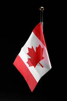 Canada flag on a black background with copy space. canada day