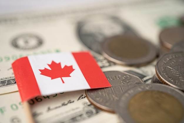 Canada flag on coins and banknotes, finance and accounting, banking concept.