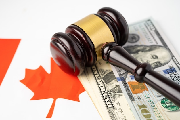 Canada flag country with gavel for judge lawyer.