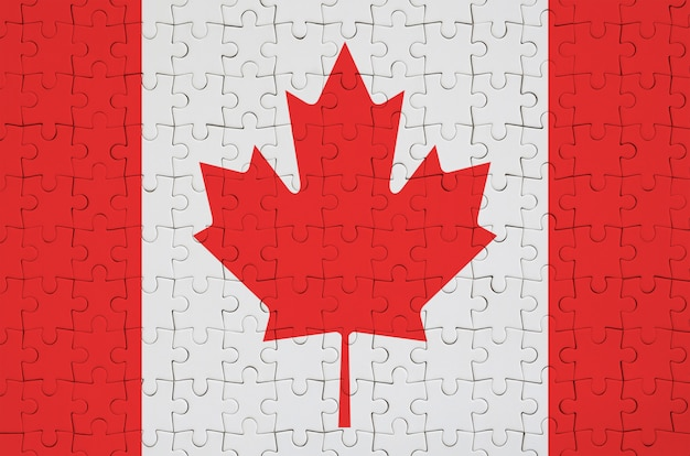 Canada flag  is depicted on a folded puzzle