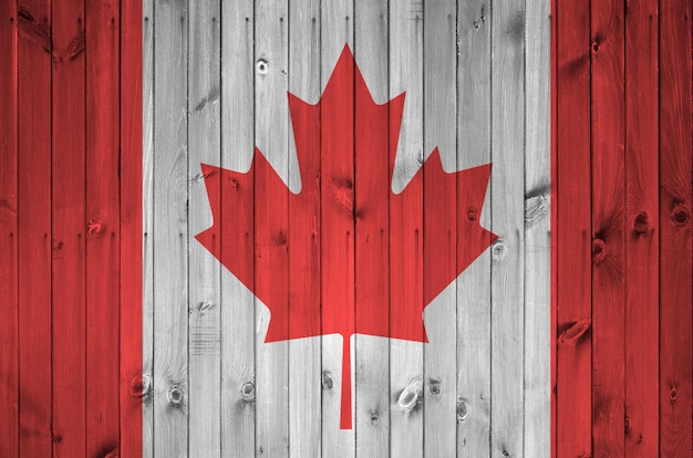 Canada flag on old wooden wall