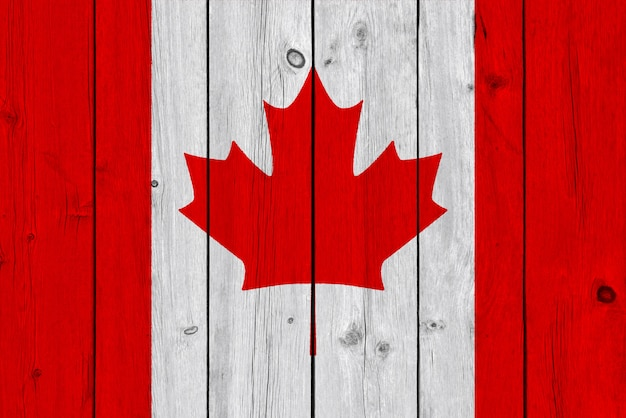 Canada flag painted on old wood plank