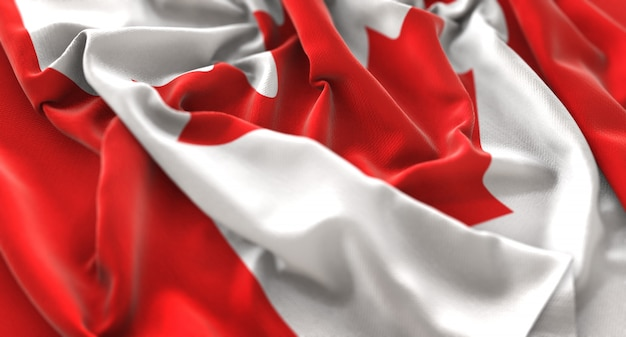 Canada flag ruffled beautifully waving macro close-up shot