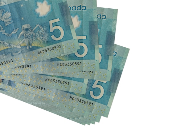 Canadian dollars bills lies in small bunch or pack isolated on white