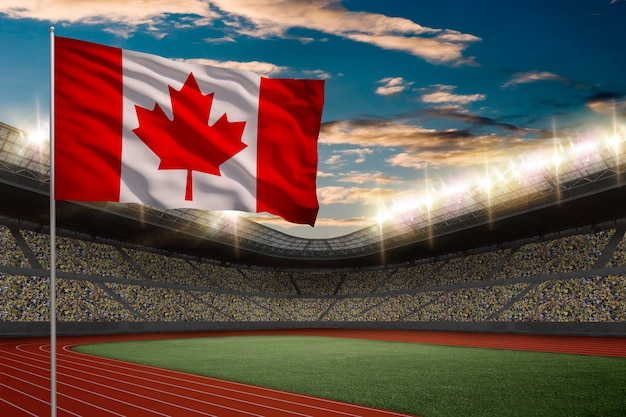 Canadian flag in front of a track and field stadium with fans.
