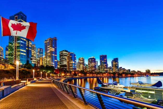 Canadian flag in front of view in vancouver downtown british columbia canada