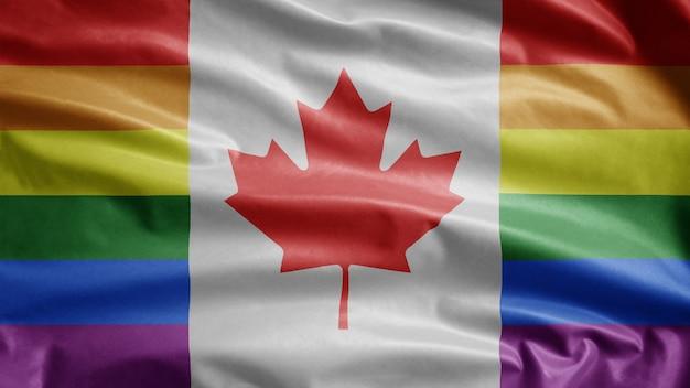 Флаг канадского гей-парада развевается на ветру. крупным планом баннер канадского лгбт-сообщества, дующий гладкий шелк. ткань ткань текстуры прапорщик фон