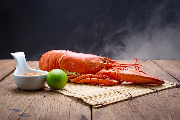 Canadian lobster on wooden background