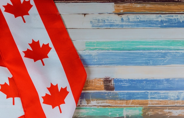 Canadian red and white flag against dark rustic background for canada day celebration and national holidays
