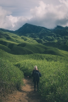 A canadian women hiking in the dzukou valley of nagaland