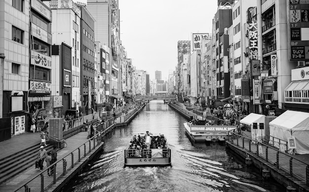 Canal in black and white with a boat