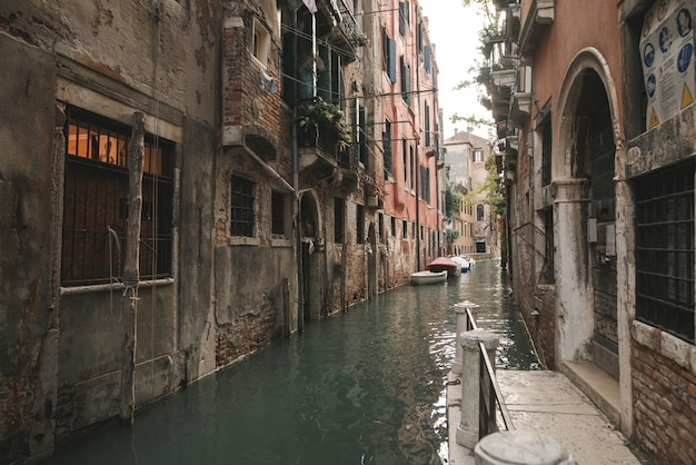 The canal and the old architecture of the residential buildings of venice.