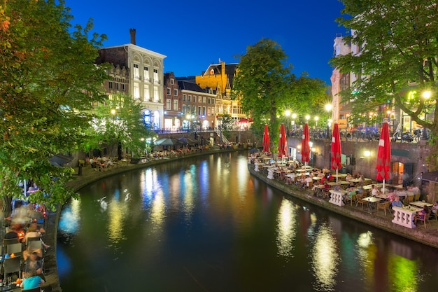 Canal oudegracht in the colorful illuminations at night, utrecht, netherlands