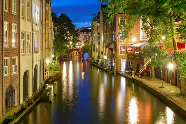 Canal oudegracht in the night colorful illuminations in the blue hour, utrecht, netherlands